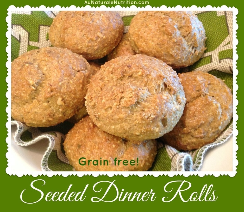 Seeded Dinner Rolls - Au Naturale! The rolls are like a nutty, whole-grain roll, but without the grains or gluten.  Ohhh Baby! Lots of fiber, too! Super delicious!  Paleo.  By Jenny @ www.AuNaturaleNutrition.com
